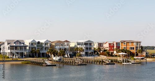 Wide angle view of luxury beach rental houses on the intercoastal waterway, Suns Fototapeta