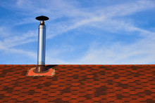 Metal Chimney On The Red Roof