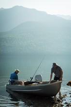 Two Fishermen Preparing For Fi...