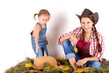 Country Mom And Daughter With Pumpkin And Hay On White Background
