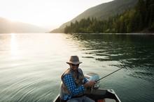 Smiling Fisherman Fishing In River