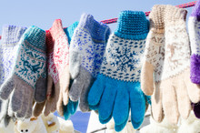 Woolen Mittens Hanging On A Ro...