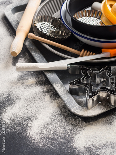 Baking utensils and accessories, cake tins. Christmas dark background