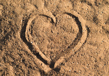 Heart In The Sand On The Beach...