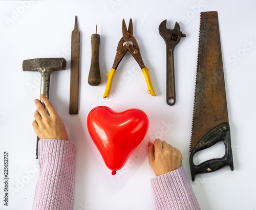 Red heart and hand tools  Love affair or breakup and divorce concept