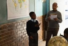 Schoolboy Using Digital Tablet...