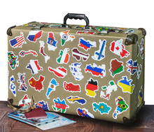 Retro Suitcase With Stickers On The Floor Isolated On White Background