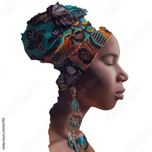 Profile side view portrait of closed eyes beautiful african woman with tradition headscarf and earrings in the border of Africa continent Canvas Print