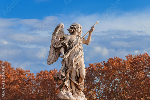 Poster Historisch mon. Angel of Autumn. Marble statue with beautiful red leaves and clouds. A 17th centuty baroque masterpiece at the top of Sant'Angelo Bridge, in the historic center of Rome