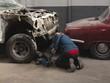 Male mechanic using trolley jack