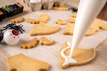 Fresh Homemade Decorating Halloween Cookies With Ghost, Creeping Spider, Bat, Haunted Castle And Horrifying Eyeball On Wooden Background, Copy Space