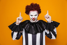 Scary Angry Clown Pointing Up At Copy Space
