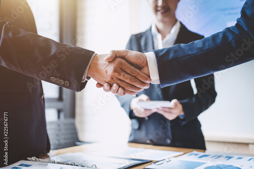 Valokuva  Finishing up a meeting, Business shaking hands after discussing good deal of Tra