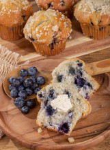 Blueberry Muffin And Spoonful Of Berries On A Wooden Plate