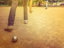 Man And Woman Playing Petanque On Sand Together O