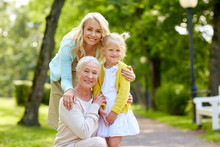 Family, Generation And People Concept - Happy Smiling Mother, Daughter And Grandmother At Park