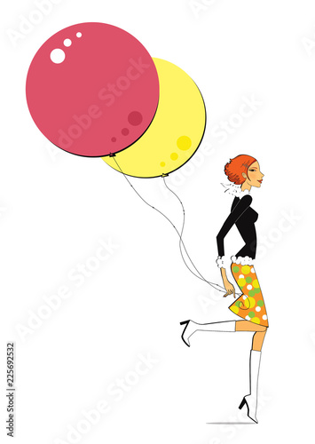 Photo  Red and yellow balloons in the hands of a walking girl
