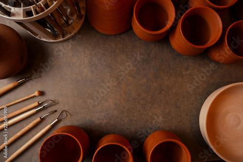 close up dirty hands of a man woman potter, creating an clay earthen jar pot on Fototapeta