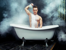 Young Man Taking A Bath With Milk