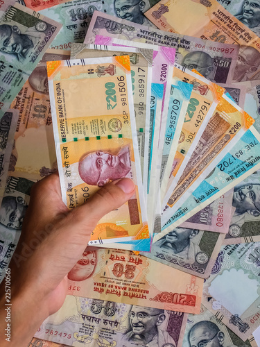 Woman's hands holding indian notes  10, 20, 50, 100, 200