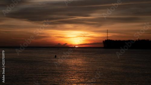 Fotobehang Zee zonsondergang Sea with sunset at evening.