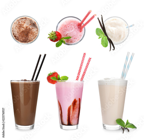 Set with different delicious milk shakes on white background