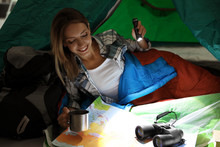 Young Woman In Sleeping Bag Wi...