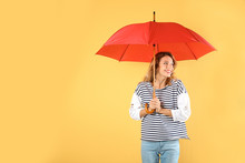 Woman With Red Umbrella On Color Background