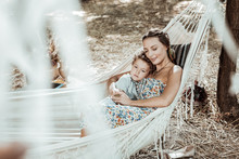 Mother Care. Happy Nice Mother And Son Lying In A Hammock Resting Together