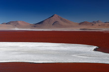 South America - Bolivia. The Surreal Landscape Is Nearly Treeless, Punctuated By Gentle Hills And Volcanoes Near Chilean Border. The Picture Present Lagoon Colorada.