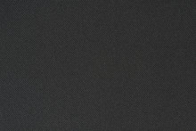 Black Texture Of Synthetic Fabric. Textile Background.