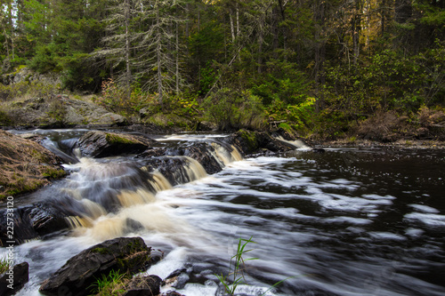 Scenic Waterfall Background. Tioga Falls at a roadside park in the Upper Peninsula of Michigan.