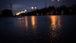 Night city, neon light, dark background, reflection of raindrops.