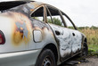 Burned out car after a car accident. Outside view.