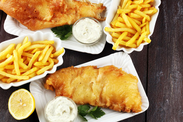 Fototapeta traditional British fish and chips consisting of fried fish, potato chips and mayonnaise
