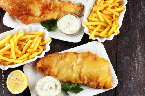 traditional British fish and chips consisting of fried fish, potato chips and mayonnaise