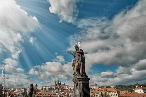 Statue of John the Baptist on the Charles Bridge with Prague Castle Fototapete
