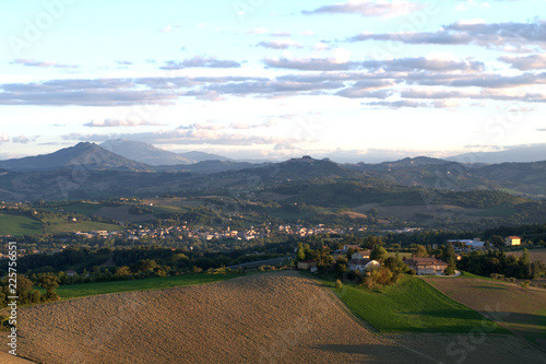Poster Diepbruine countryside,panorama,landscape,hills,village,crops,field,mountains,view,clouds,agriculture