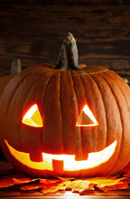 Carved Jack O Lantern On A Woo...