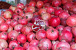 Leinwanddruck Bild - KASHGAR, XINJIANG / CHINA - October 1, 2017: Close up of pomegranates - on display for sale at a market in Kashgar. Pomegranates originate in the region extending from Iran to northern India.