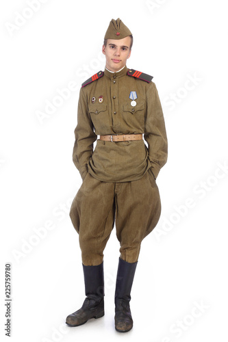 Fotografia  A soldier in military uniform of soviet army stay with both hands in pockets