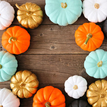 Autumn Square Frame Of Various Colorful Pumpkins On A Rustic Wood Background. Top View With Copy Space.