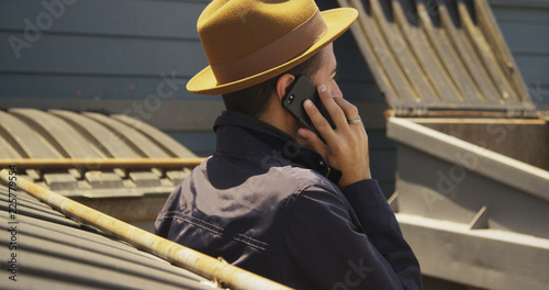 Mexican man talking on smartphone outdoors
