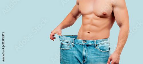 Fotografia Man wearing big jeans after diet, weight loss