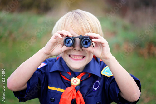 Young Tiger Cub Scout Smiling at Camera Through Binoculars Canvas Print