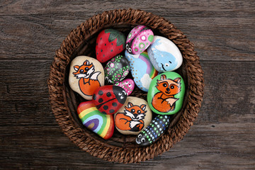 Collection of Hand Painted Colorful Cartoon Rocks in w Wicker Basket