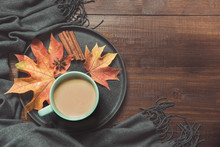 Autumn Still Life With Cup Of Coffee, Colorful Dry Leaves Warm Scarf On Wooden Board. Copy Space. Top View.