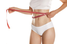 Young Woman Measure Her Waist With Tape On White Background