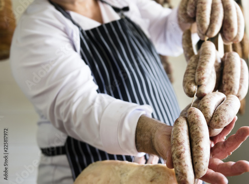 Photo  Butcher selling sausages on a string