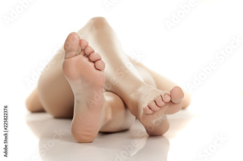 female bare feet on white background Canvas Print